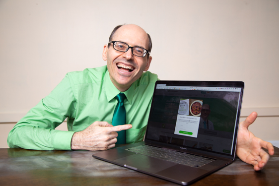 Dr. Greger Smiling with Computer