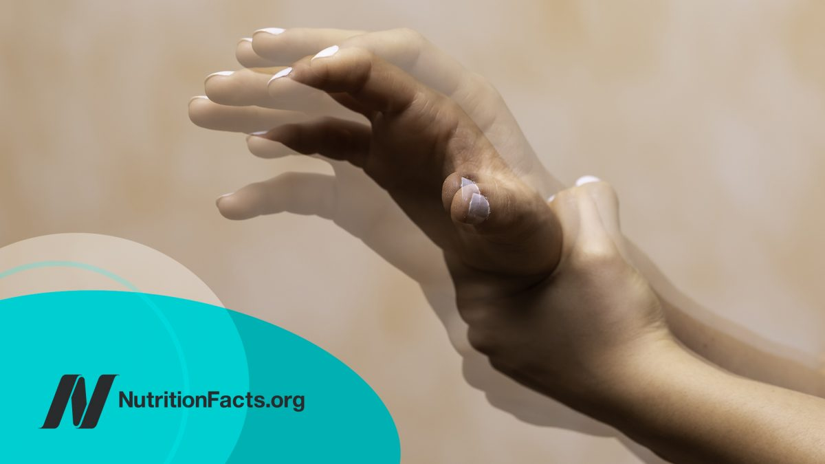 Closeup view on the shaking hand of a person suffering from Parkinson's disease