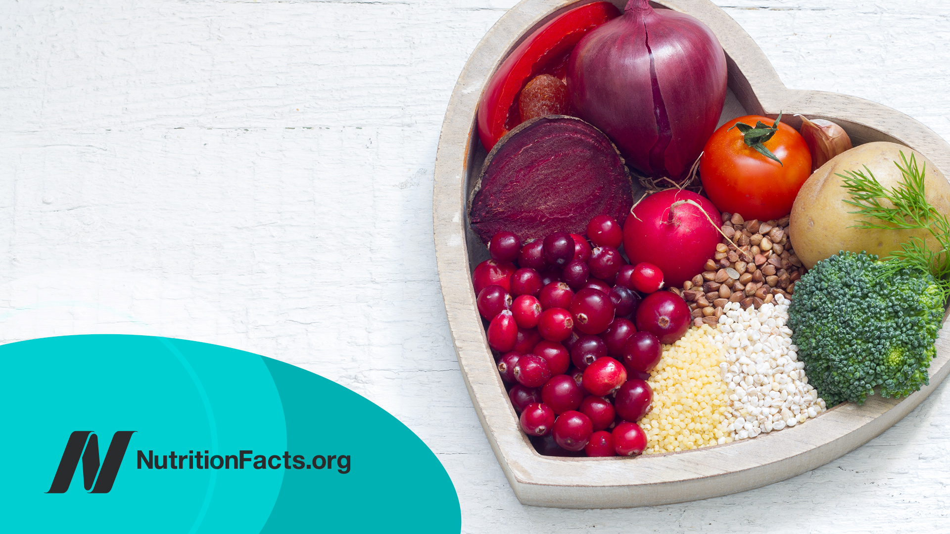 Healthy fruits and vegetables in heart shaped bowl