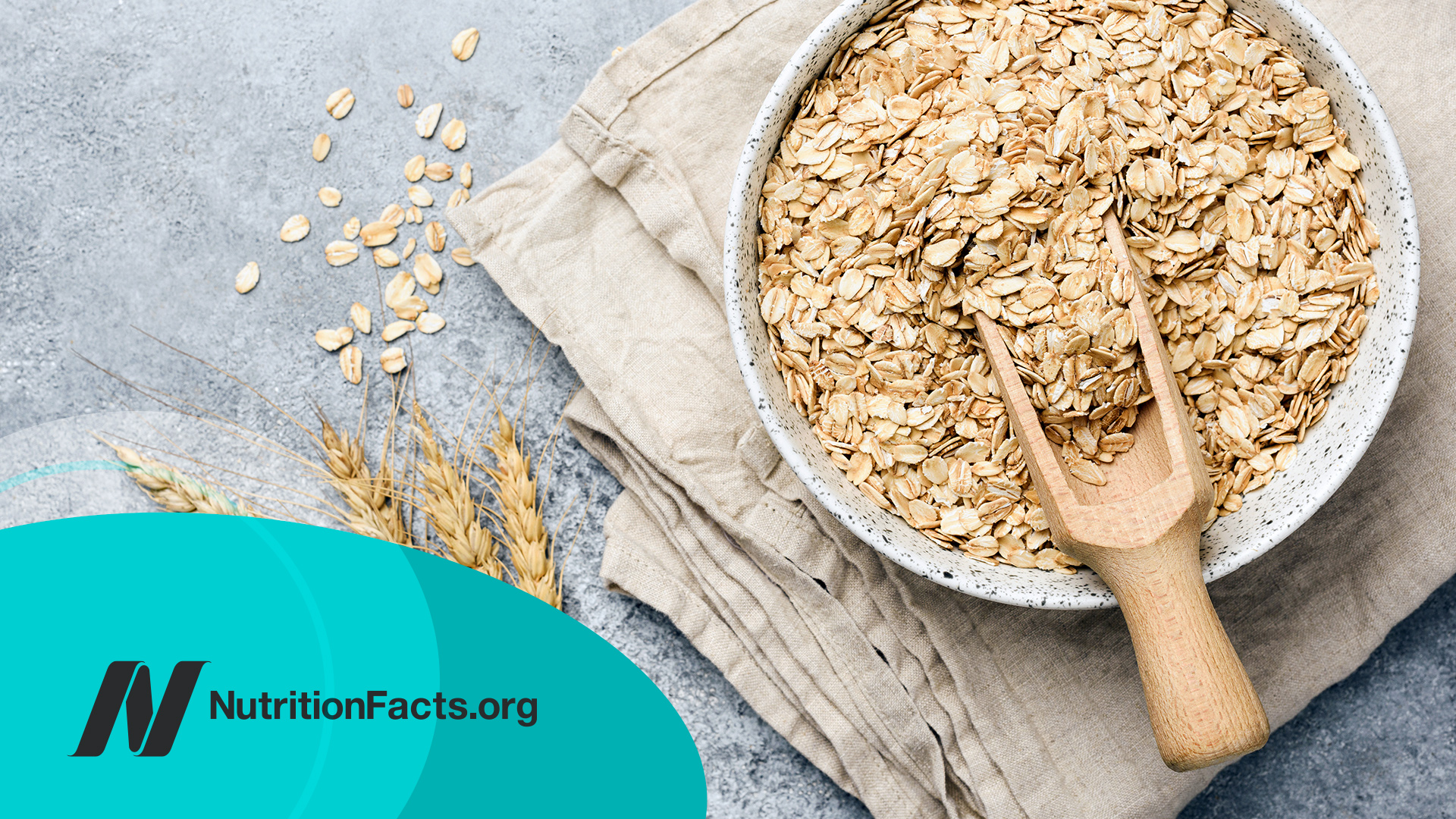 Oat flakes, oats or rolled oats in a bowl on a stone countertop