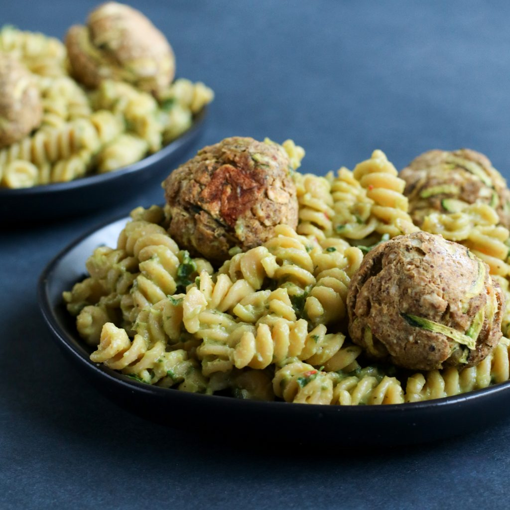 Gemelli with Zucchini Meatballs on slate background